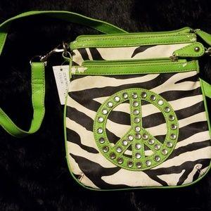 Black and white zebra bag with green trim.